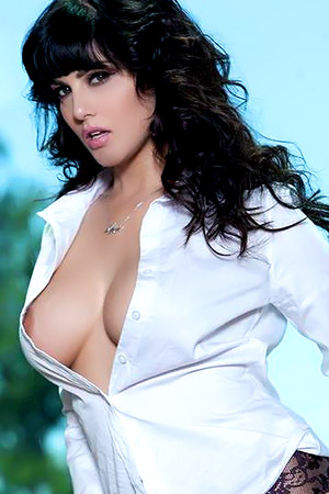 Sunny Leone in 'Busty Porn Star in White Shirt and High Heels' via Sunny Leone Official