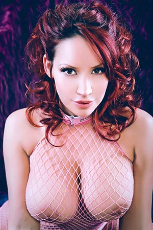 Bianca Beauchamp in 'Pink Fishnet Bodysuit' via
